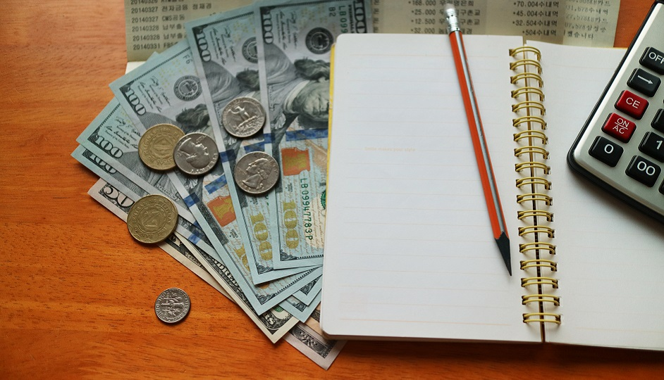 Financial analytics: money, note, calculator and a pen